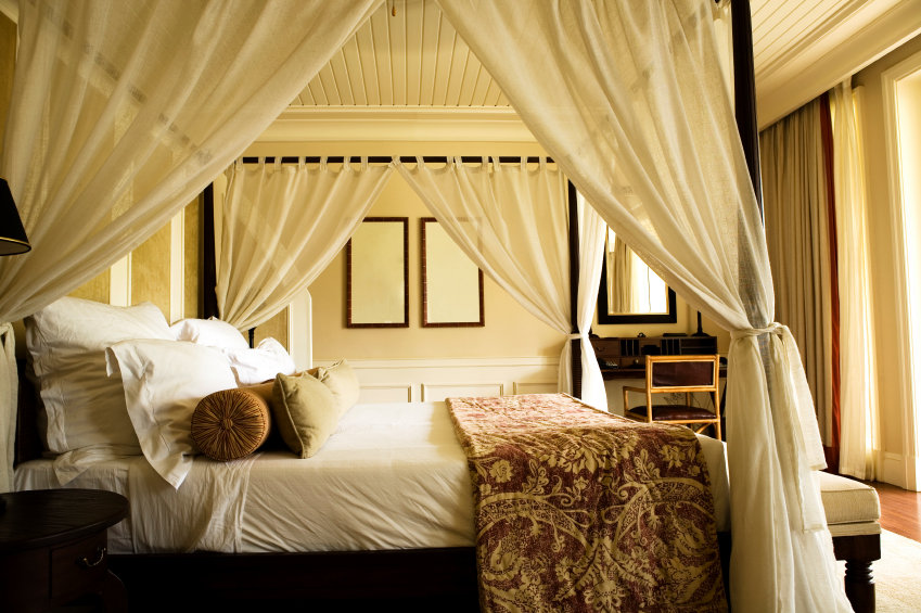 Four poster bed in a tropical resort.